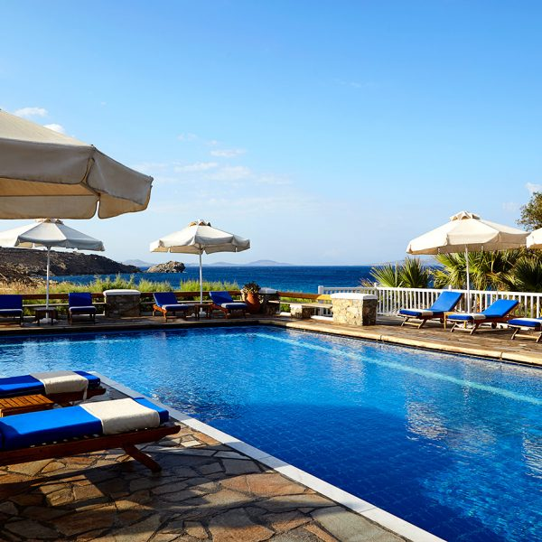 Guests at San Marco can relax & sunbathe on loungers by the hotel pool with a view of Houlakia Bay