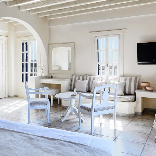 TV & sofa seating area in the Junior Open Plan Sea View Suites at San Marco Luxury Hotel in Mykonos