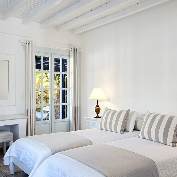 Twin beds in the Classic Garden View Rooms at the San Marco luxury Houlakia Bay Hotel in Mykonos