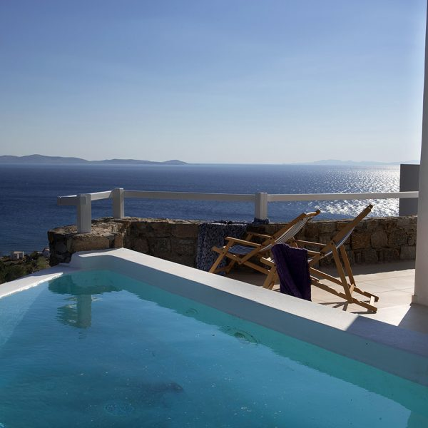 Deckchairs by the Houlakia bay sea view private pool at the San Marco Hotel Asteria Villa in Mykonos