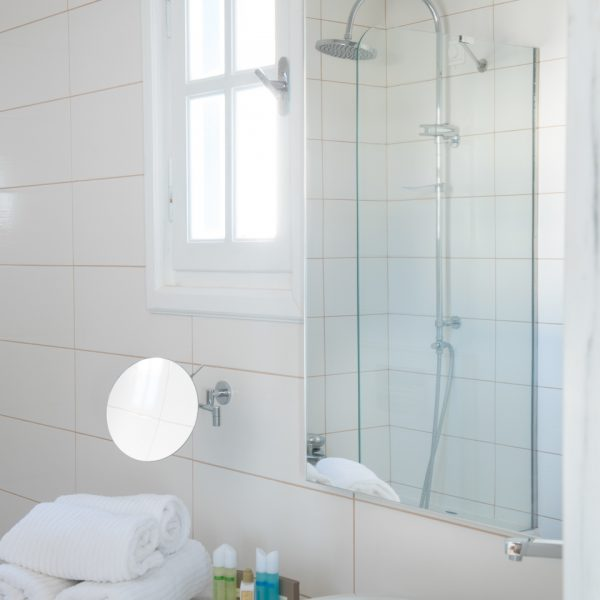 Sea view Anemos Honeymoon Suites bathroom with mirrors, washbasin & towels in Houlakia Bay, Mykonos