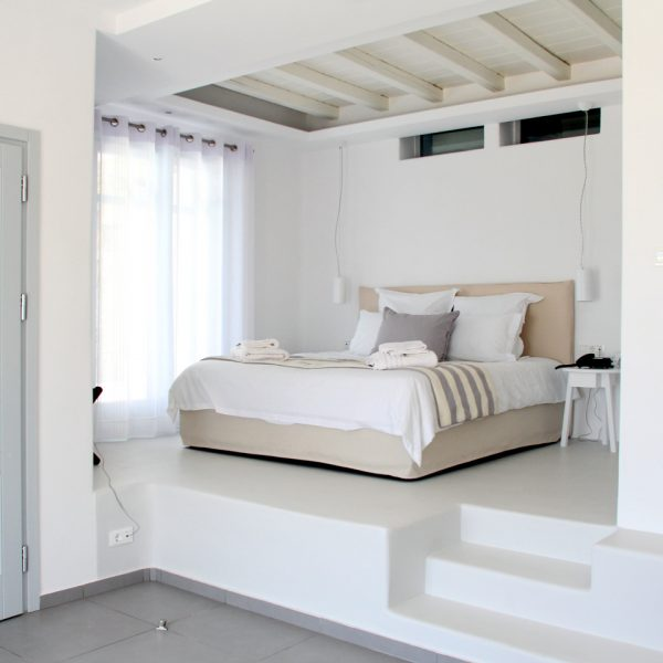 Bed on a plinth in the Hera twin bedroom Villa with private pool at San Marco Hotel in Mykonos