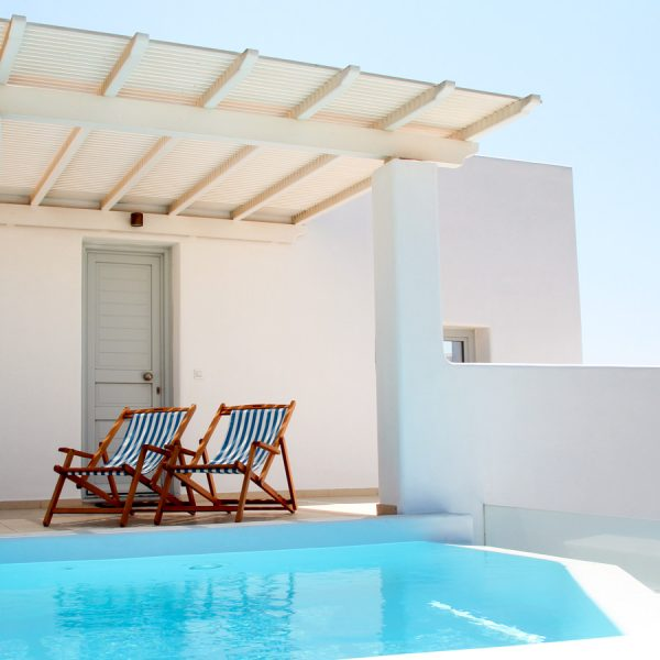 The San Marco hotel sea view luxury Asteria Villa in Mykonos has a private pool with deckchairs