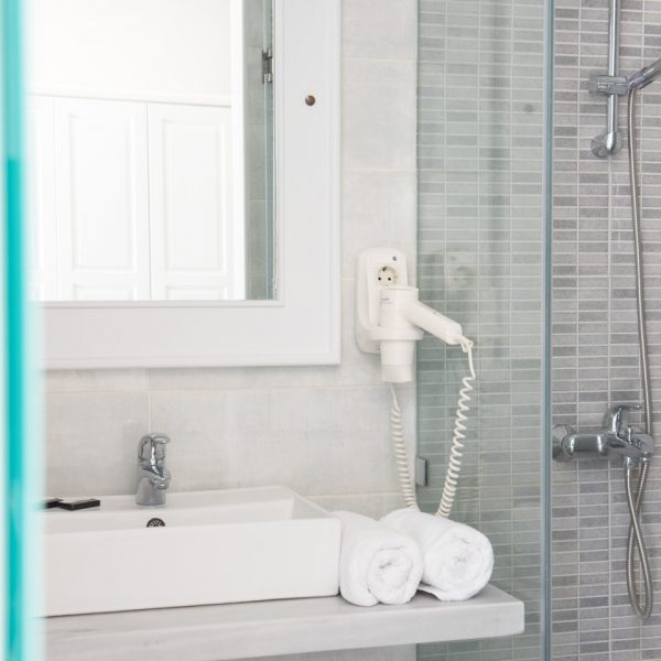 Stylish bathroom in San Marco Classic Garden View Rooms, with hairdryer, washbasin, shower & mirror