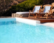Deckchairs beside a private pool at the San Marco Hotel luxury Petite Private Villas in Mykonos