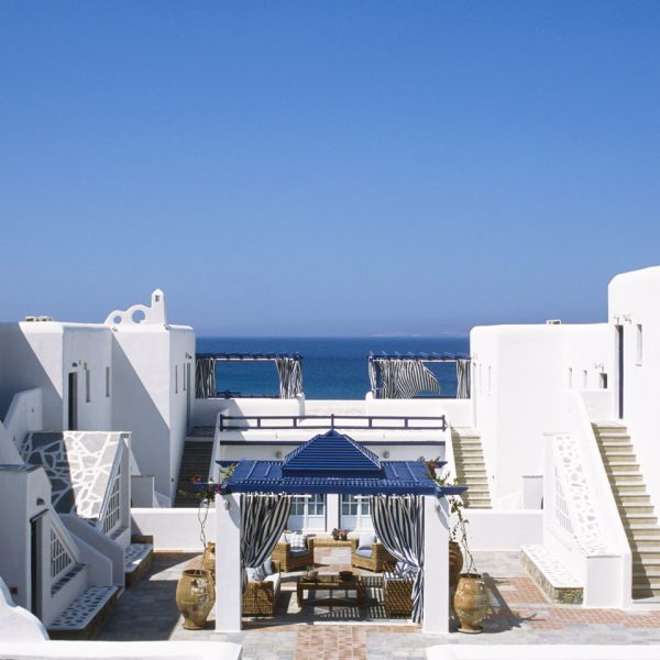 The San Marco Luxury Hotel by the sea in Houlakia Bay has traditional Cycladic design architecture