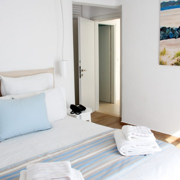 A chic design bedroom in the sea view Leto Villa at San Marco luxury hotel in Houlakia Bay, Mykonos