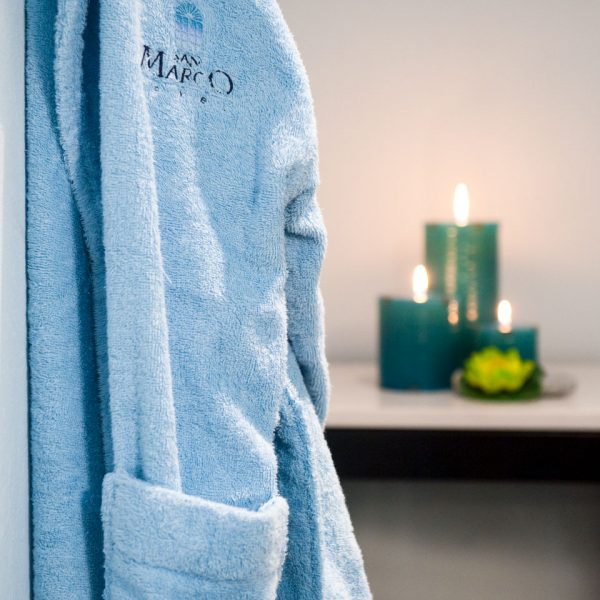 A blue San Marco Hotel robe is used to make guests feel comfortable during their Houlakia spa visits