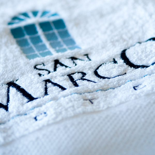 The San Marco Mykonos Hotel Houlakia Boutique Spa towel.