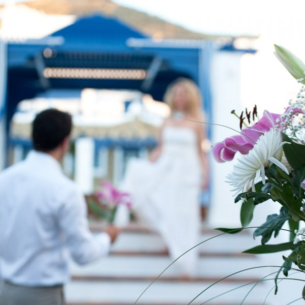 A groom welcomes his bride during their wedding celebration at the San Marco Mykonos Luxury Hotel