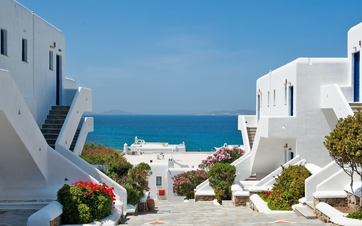 Trees & flowers line the pathways at San Marco Luxury Hotel & Villas in Houlakia bay, Mykonos