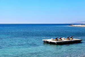 Sunbathing facilities at San Marco Luxury Mykonos Hotel include an island deck in Houlakia bay