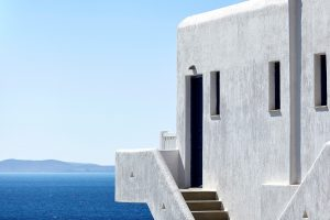 The whitewashed Cycladic design of the San Marco Mykonos Luxury Hotel that overlooks Houlakia bay
