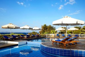 San Marco luxury Hotel swimming pool & sun lounger facilities overlooking the sea & Houlakia bay