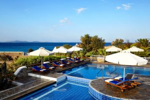 Sunbeds & umbrellas surrounding the seawater pool at the San Marco Luxury Hotel & Villas in Mykonos