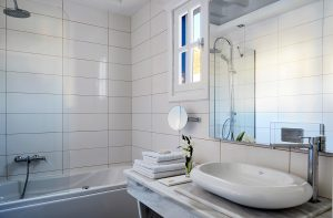 Stylish design luxury bathroom of Anemos Honeymoon Suites at San Marco Hotel & Villas in Mykonos
