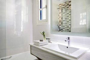 Basin, mirror, towels & toiletries in a luxury bathroom of the Classic Garden View Rooms in Mykonos