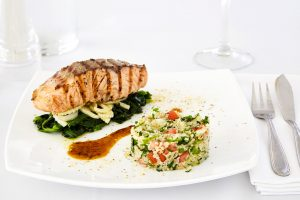 San Marco Hotel's gourmet restaurants offer dishes like grilled salmon on a bed of spinach with rice
