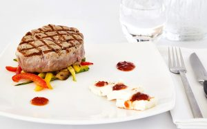 Delicious gourmet dish of filet mignon beef with vegetables at San Marco Mykonos Hotel restaurant