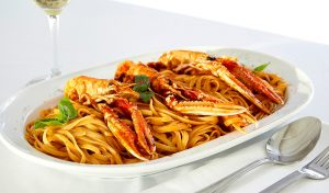 San Marco Luxury Mykonos Hotel & Villas gourmet restaurants dish of lobster & ribbon spaghetti