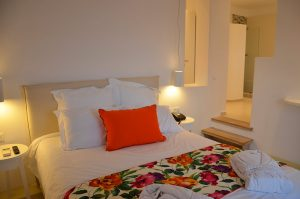 Bedside tables & bed in Artemis maisonette villa with private pool at San Marco Hotel in Mykonos