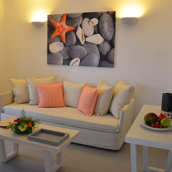 The San Marco Asteria Villa in Mykonos has a lounge sitting area with TV, sofa & coffee table