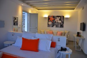 The bedroom & lounge sitting area in the open plan Asteria Villa at San Marco Hotel in Houlakia Bay