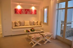 Spotlights illuminate the sofa, coffee table & stools in the sitting area of Hera Villa in Mykonos