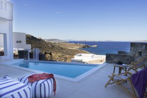 View of the blue sea of Houlakia bay from the private pool & veranda of the Hera Villa in Mykonos
