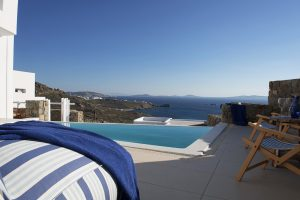 Bean bag & deckchairs by San Marco Mykonos Hotel Hera Villa private pool face Houlakia Bay & the sea