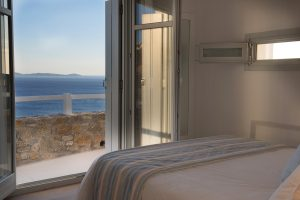The sea view of Houlakia Bay seen from a bedroom in the Leto private pool villa at San Marco Mykonos
