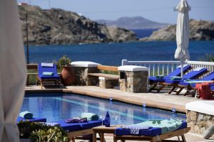 The San Marco Mykonos Hotel pool with a view of the Aegean sea, is ideal for enjoying the summer sun.
