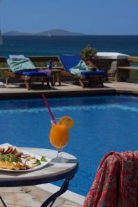 Orange juice & snacks by the sea view pool facilities at San Marco luxury Hotel & Villas in Mykonos