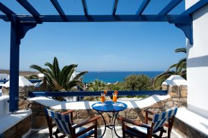 Table with cocktails on San Marco Junior Open Plan Suites sea view veranda in Houlakia bay, Mykonos