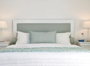 Large bed and bedside tables with reading lamps of the San Marco Hotel Anemos Honeymoon Suites.