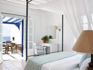 Sea view Anemos Honeymoon Suites at San Marco Mykonos Hotel have a romantic large 4 poster bed