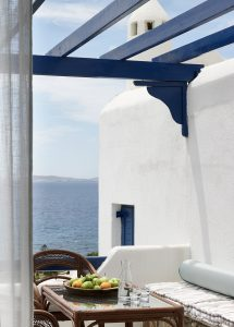 The San Marco Hotel Anemos Honeymoon Suites veranda with sofa, coffee table, chairs and sea views.