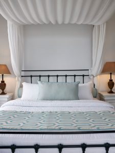 The San Marco Hotel Anemos Honeymoon Suites large and very comfortable 4 pillar bed.