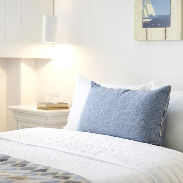 One of the twin beds of the Junior open plan sea view suites of the San Marco Mykonos Hotel
