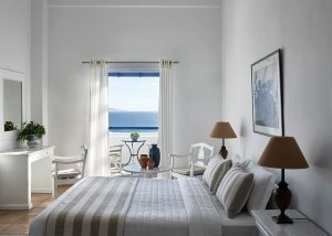 The loft suites of the San Marco Mykonos Hotel offer views of the Aegean and large double beds.