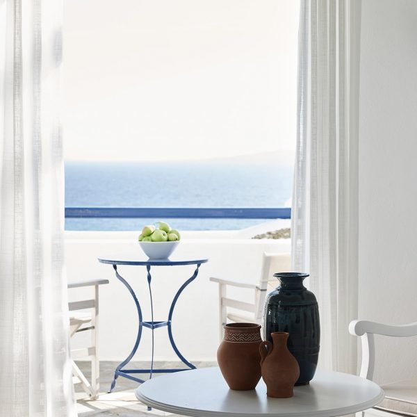Coffee table and chairs on the veranda of the loft suites of the San Marco Mykonos Hotel.