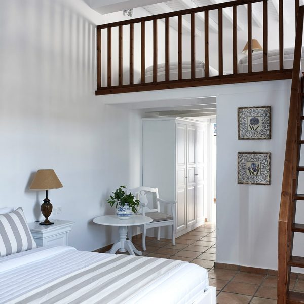 Wooden stairs leading up to the second floor of the loft suites of the San Marco Mykonos Hotel.