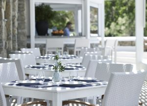 Laid tables at the Pythari restaurant in Mykonos. Pythari is part of the San Marco Mykonos Hotel.