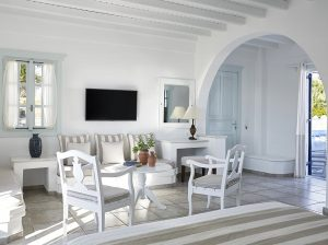 Sea view Cyclades Junior Suites bedroom sofa, TV, table & chairs at San Marco Hotel in Mykonos