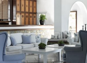The San Marco Mykonos Luxury Hotel lounge. Coffee tables, sofas and armchairs provide comfort.