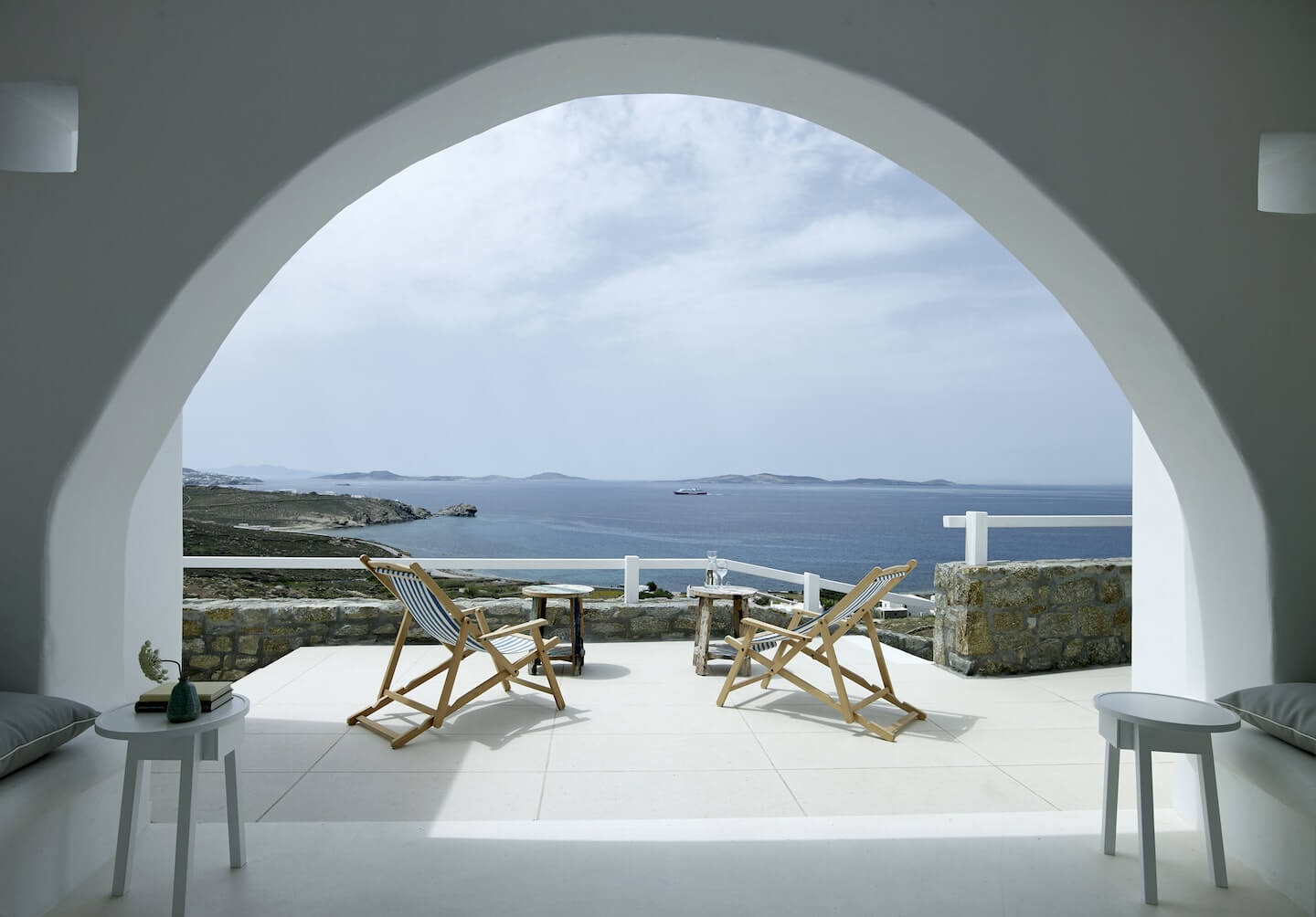 Archway of one of the luxury San Marco villas in Mykonos with a view to the Aegean sea.