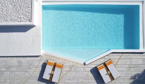 Top view of the private pool of one of the San Marco Sunset Collection villas in Houlakia bay.
