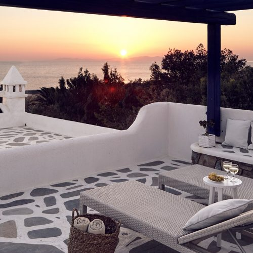 Sunbeds facing sunset sea view on Anemos Honeymoon Suites private veranda at San Marco Mykonos Hotel