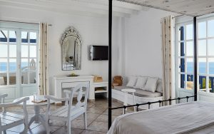 Luxury bedroom area with furniture in Sea View Anemos Honeymoon Suites at San Marco Hotel in Mykonos