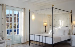 Four poster bed in sea view Anemos Honeymoon Suites at San Marco Hotel in Houlakia Bay, Mykonos